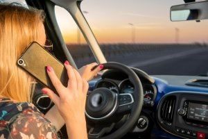 Woman driving while talking on the phone